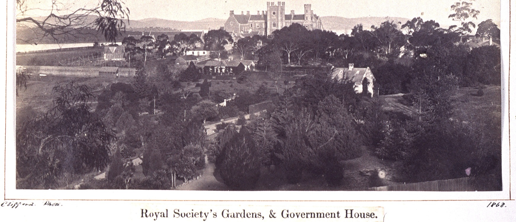 black and white image of Royal Society's Gardens, and Government House from upper domain mid 1800's
