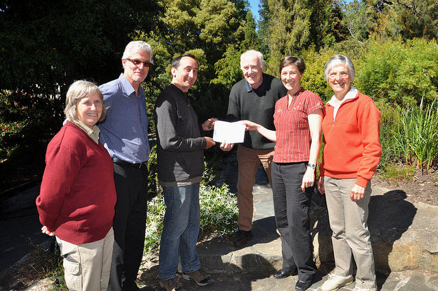 Australian Plant Society (Hobart Group) President Bruce Champion, accompanied by Christine Howell and Chris Corbett donating a cheque for $3000